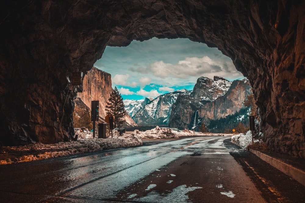 empty road tunnel leading to mountains