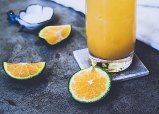 citrus juice on glass near towel
