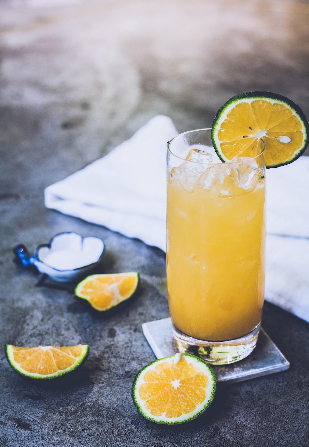 citrus juice on glass near towel