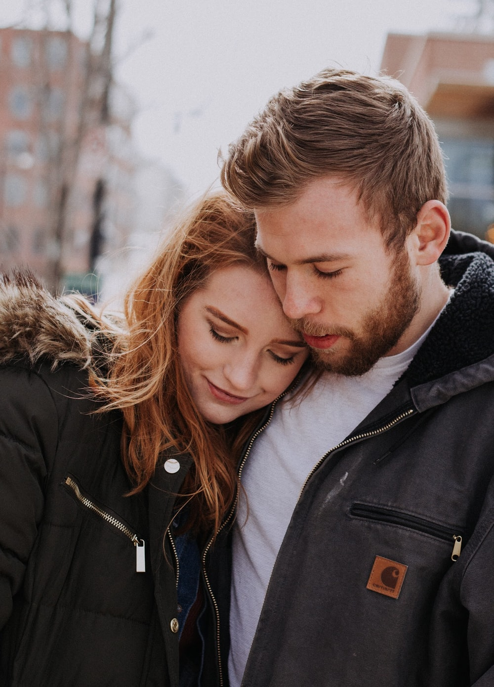 man hugging woman standing on road