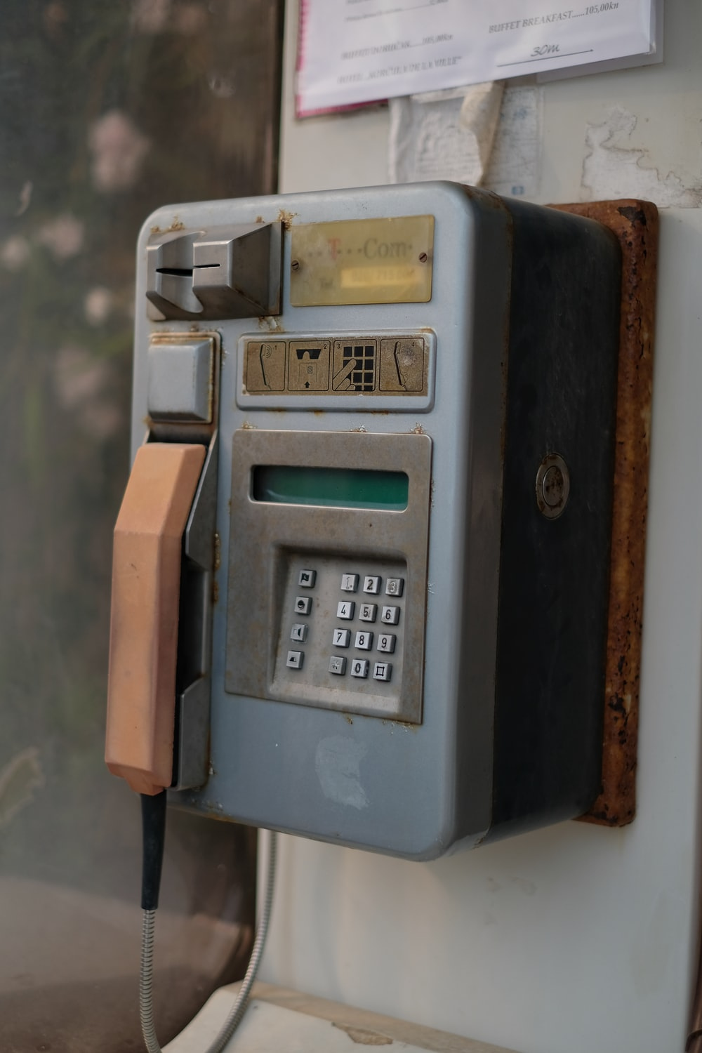 gray and brown payphone on focus photo