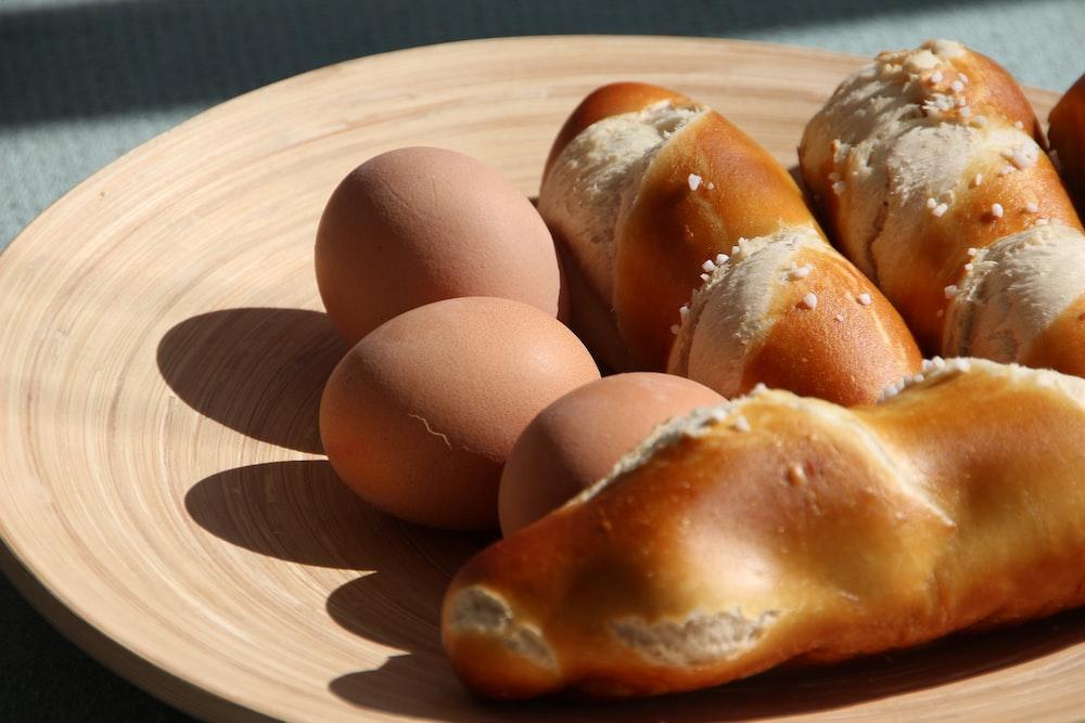 three organic eggs and three breads