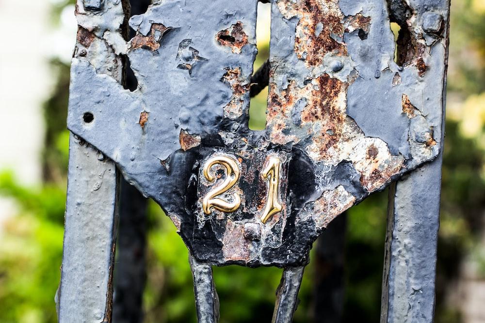 21 embossed on gate