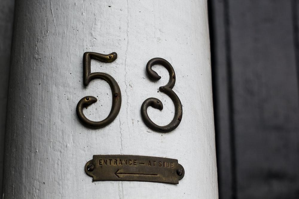 closeup photography of 53 signage
