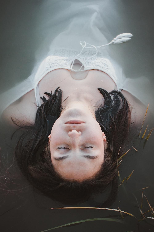 woman lying on bathtub