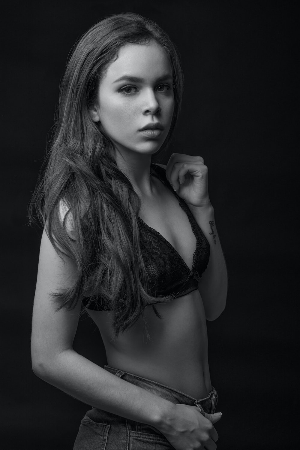 grayscale photography of woman wearing brassiere
