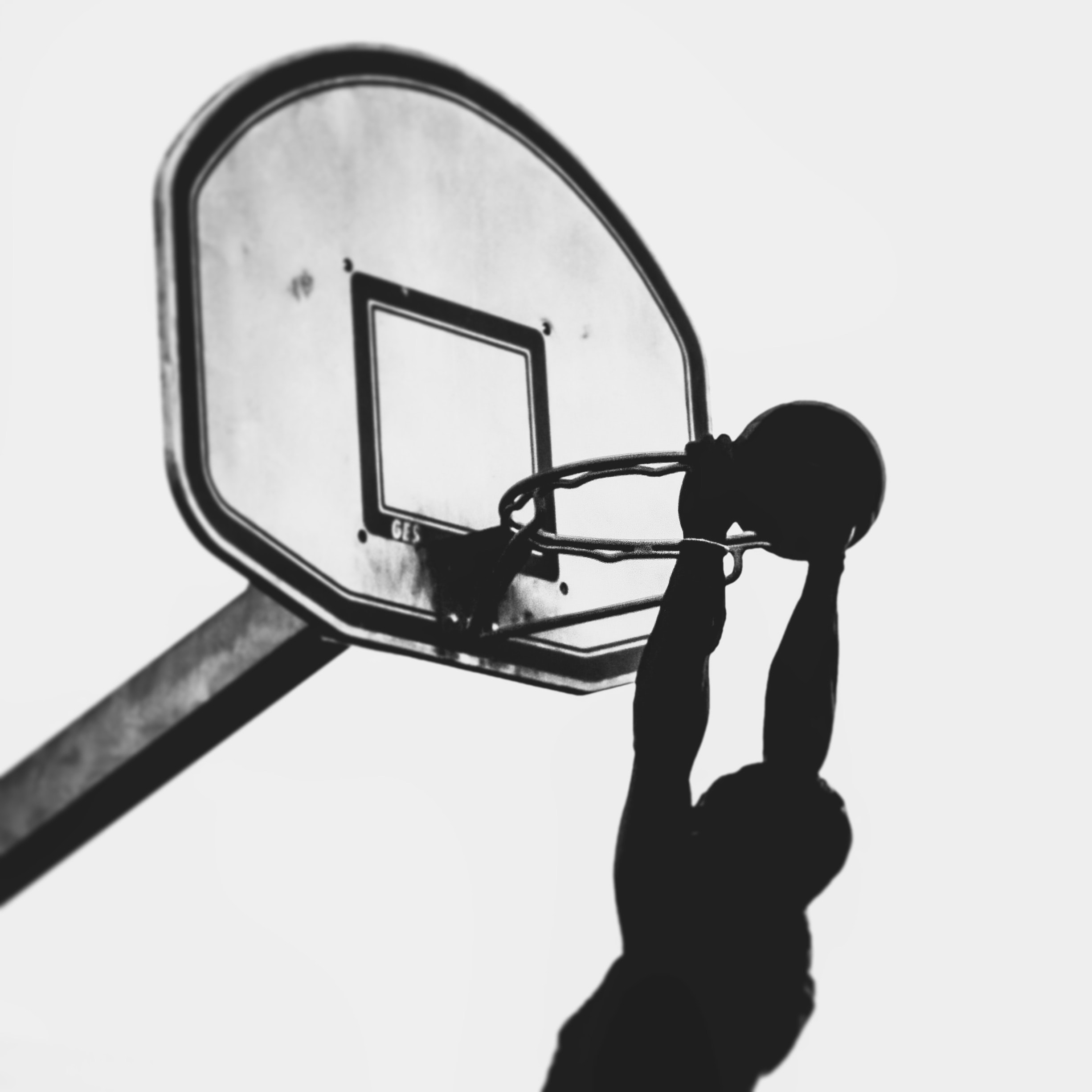 silhouette of man about to dunk