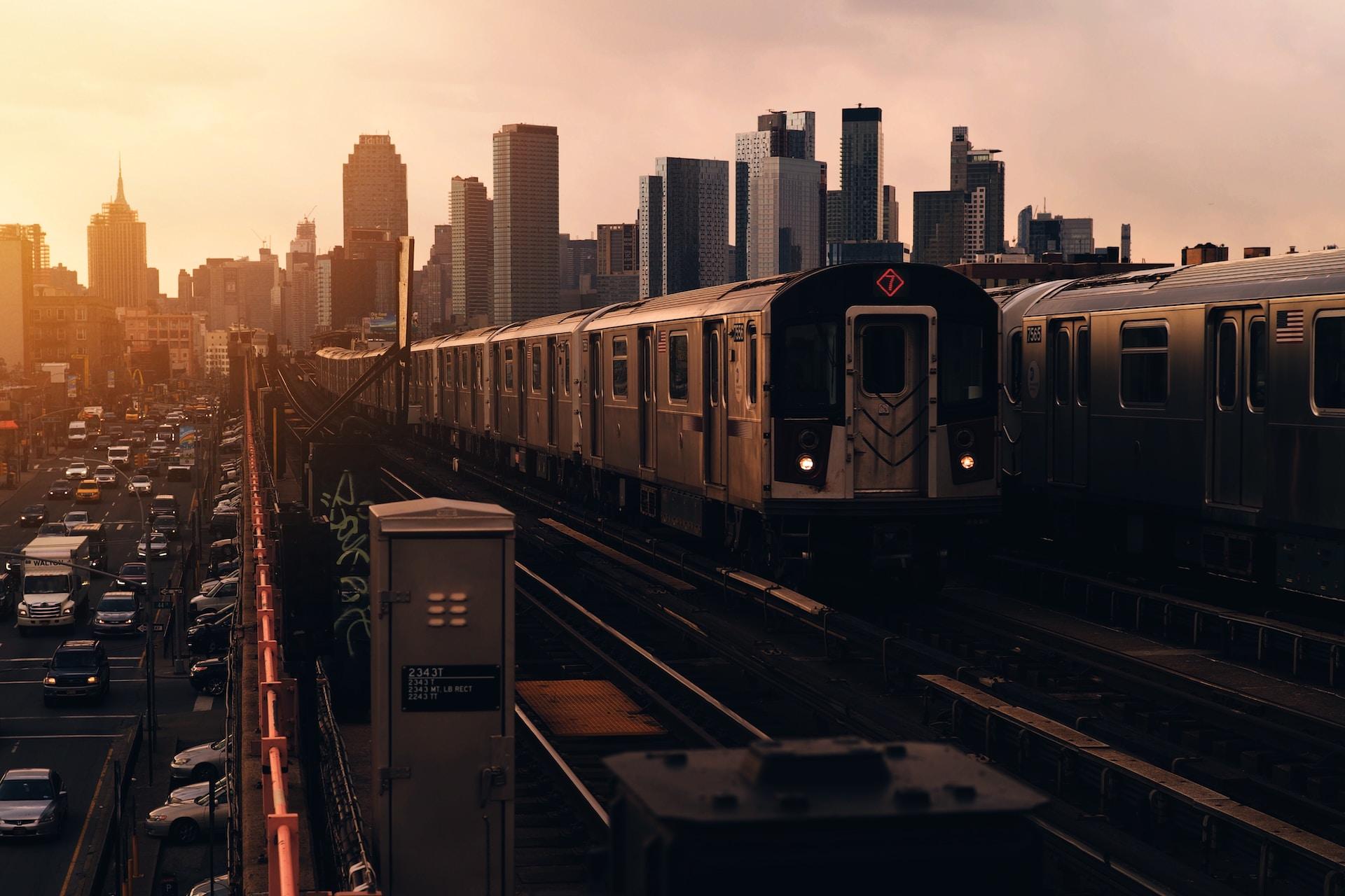 train approaching near high-rise buildings