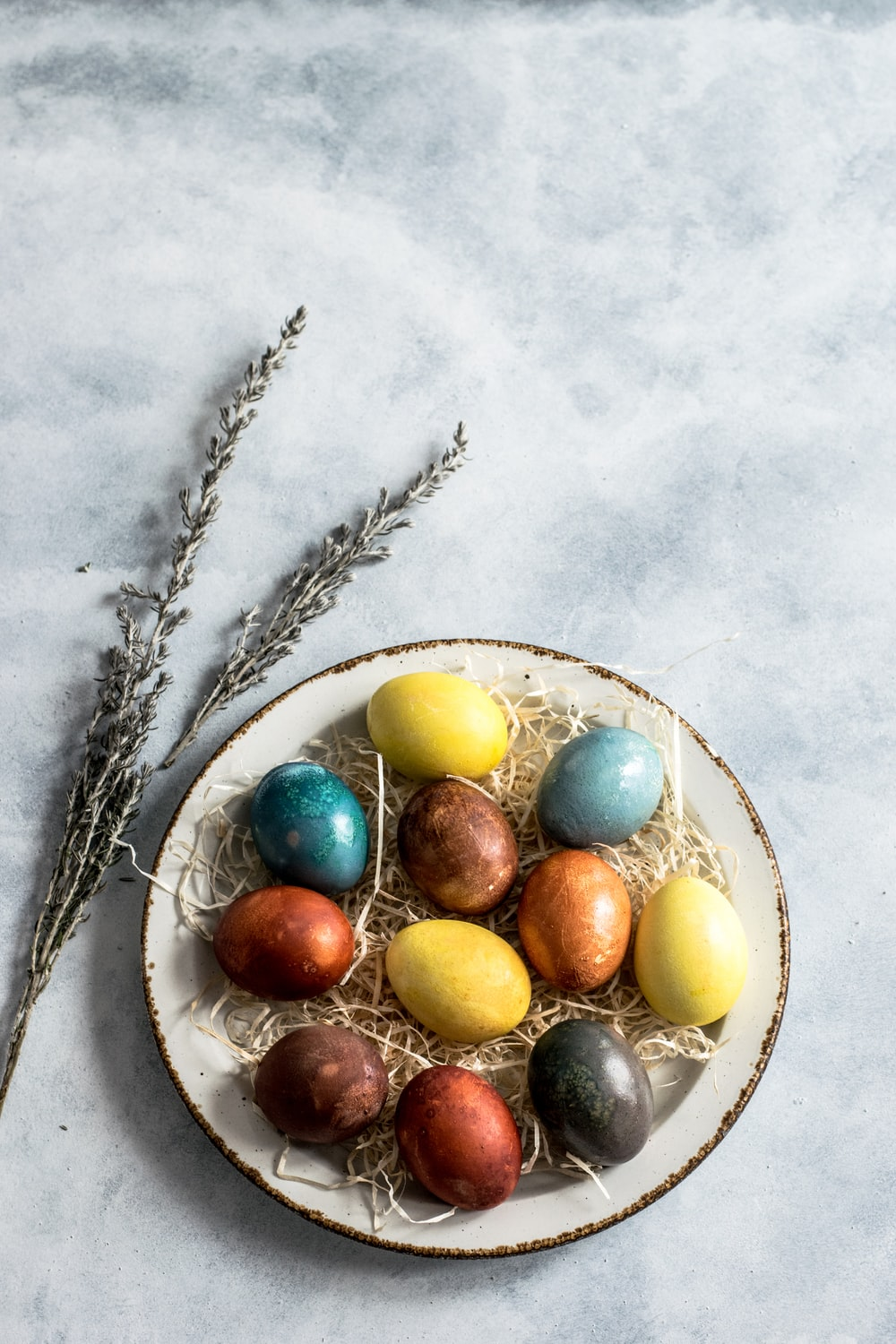 assorted-color eggs on white ceramic tray