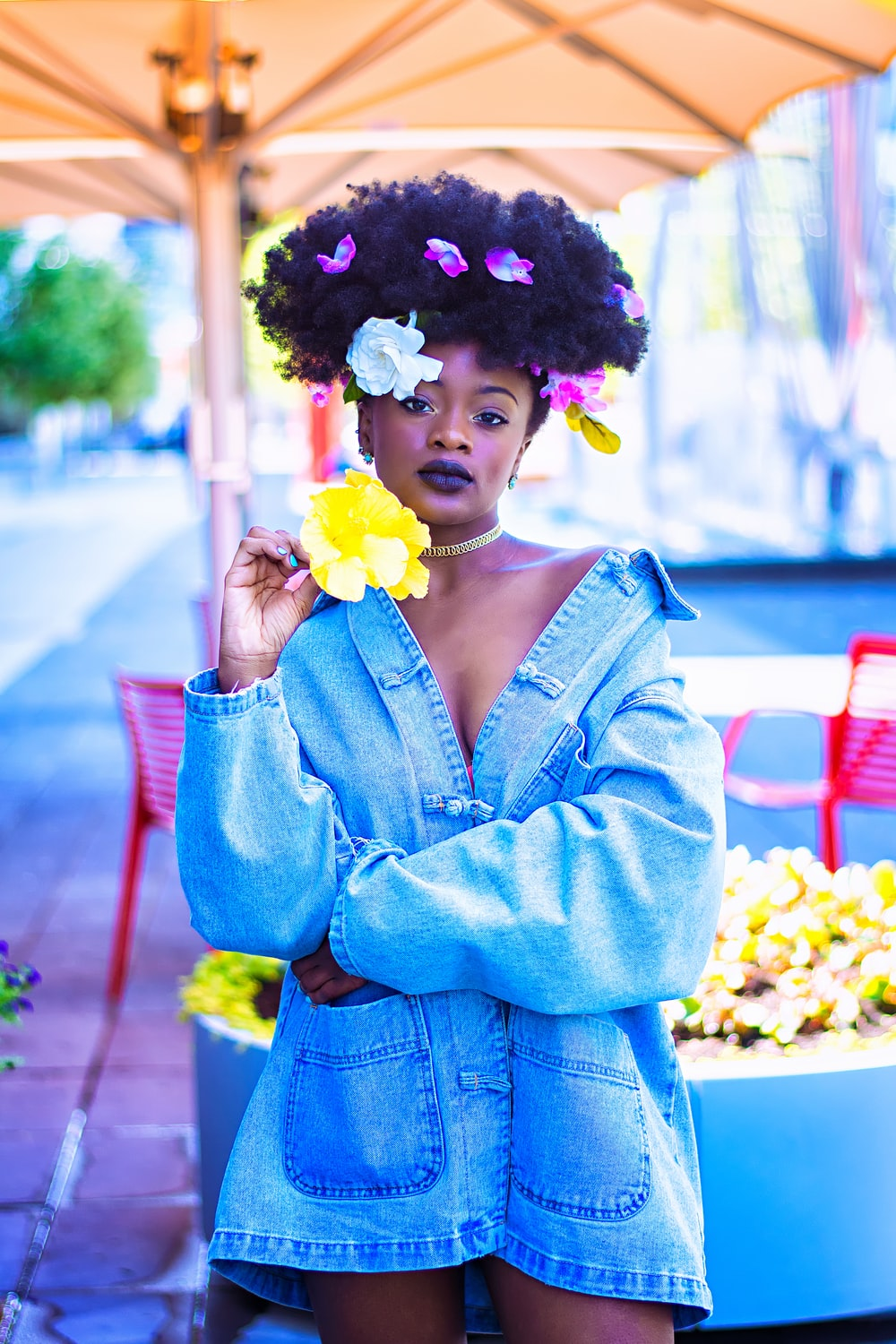 woman wearing blue denim jacket with flowers on hair