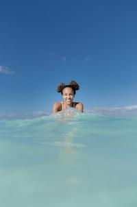 women smiling on water