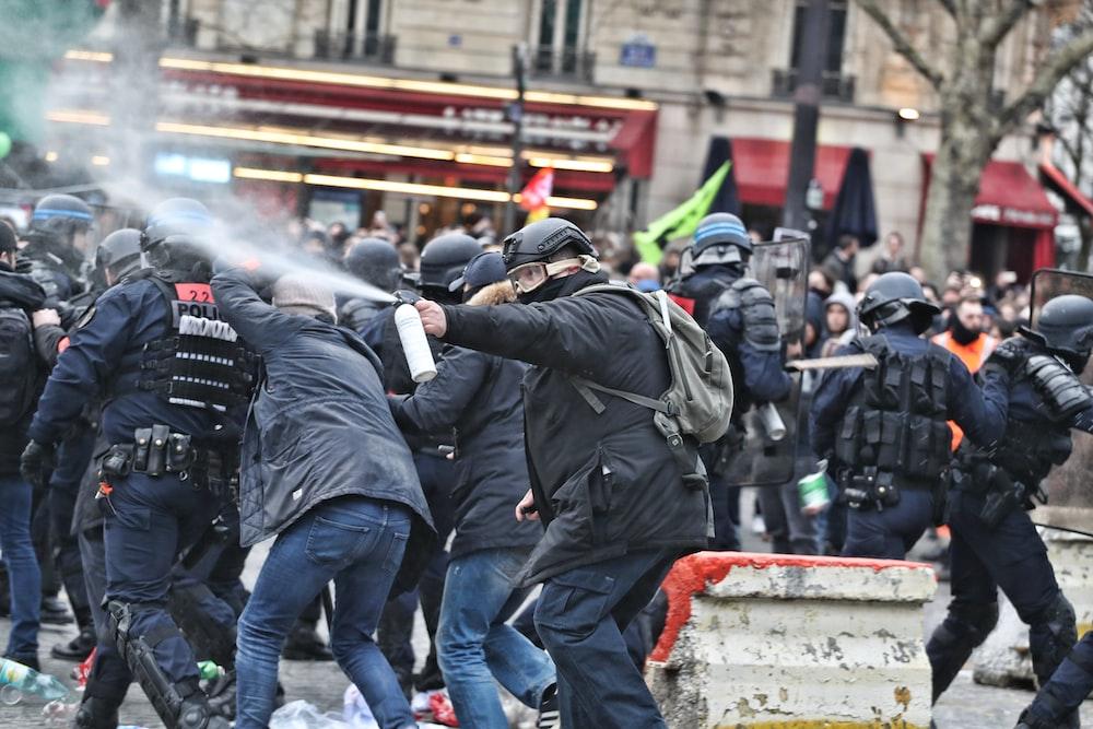 riot police spraying unto protesters