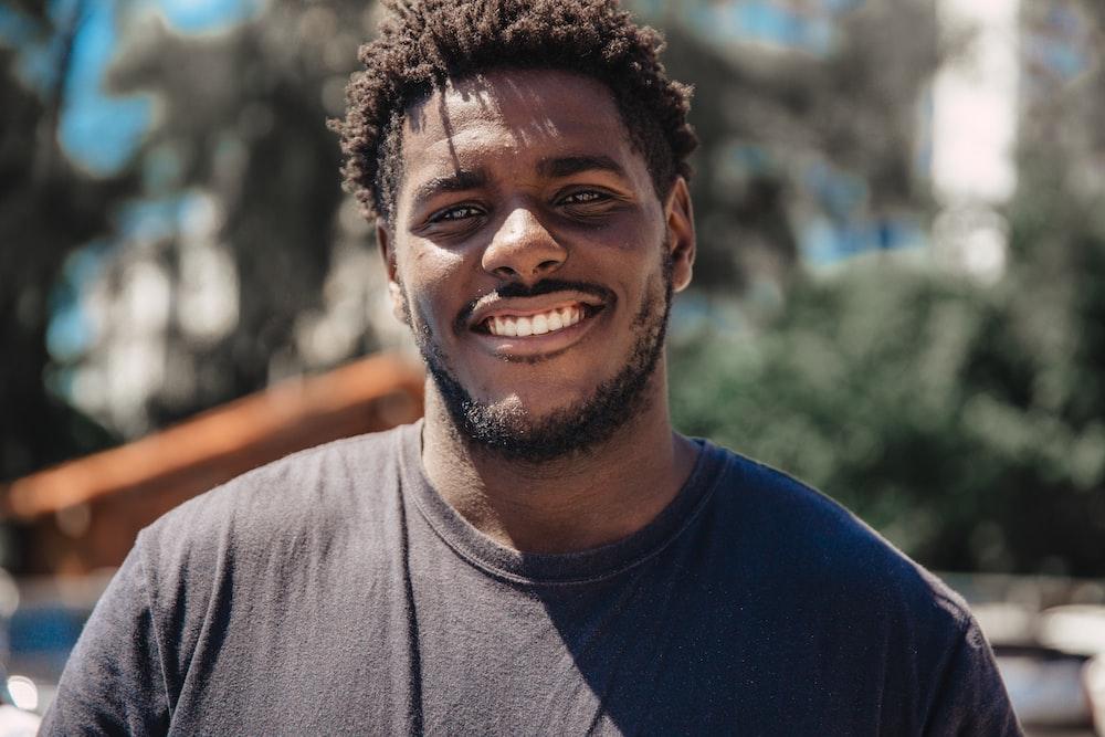 selective focus of man smiling during daytime