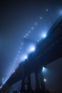 low angle photography of bridge during nighttime