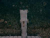 aerial view of woman laying on dock