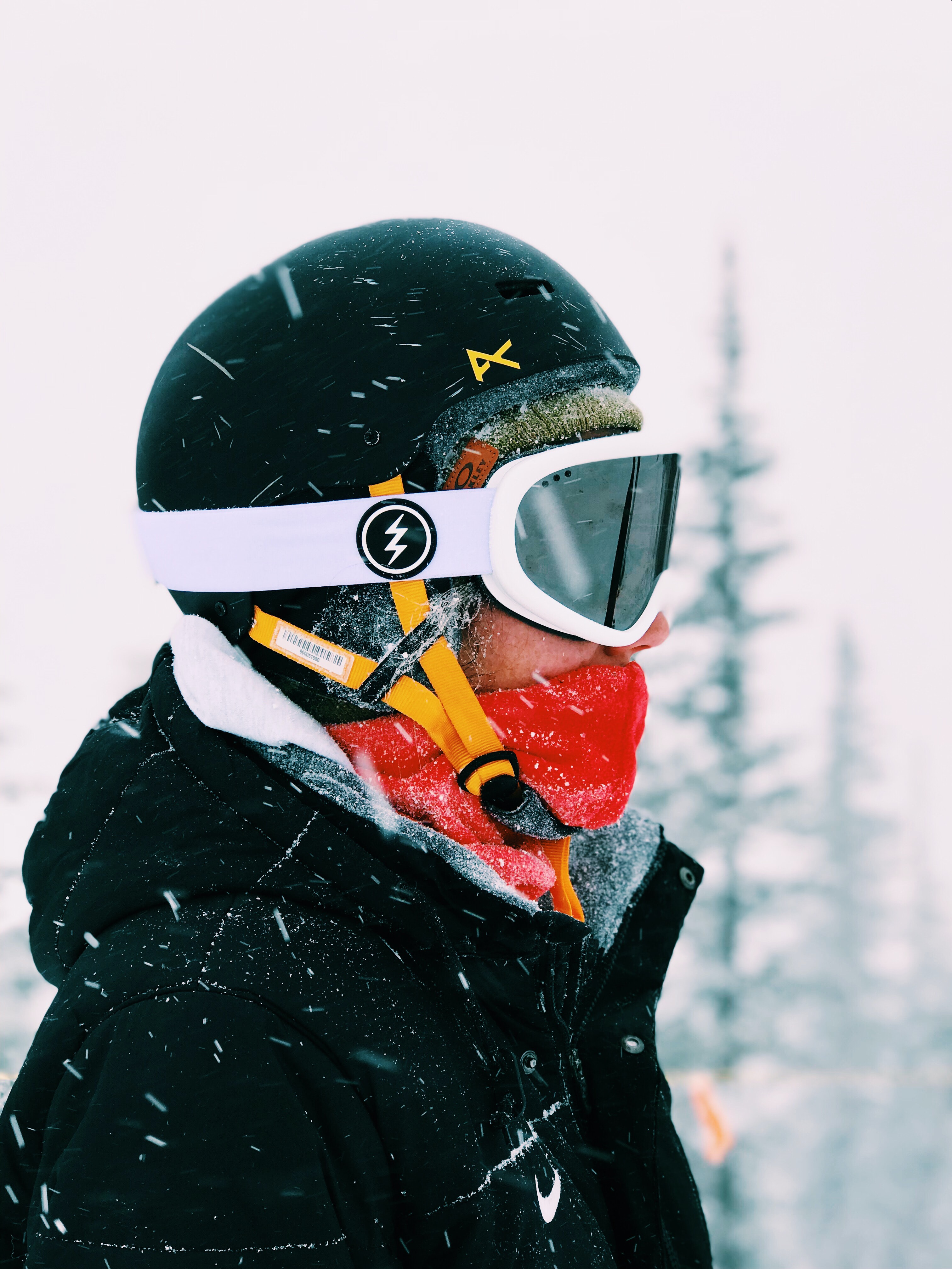person wearing white snow goggles