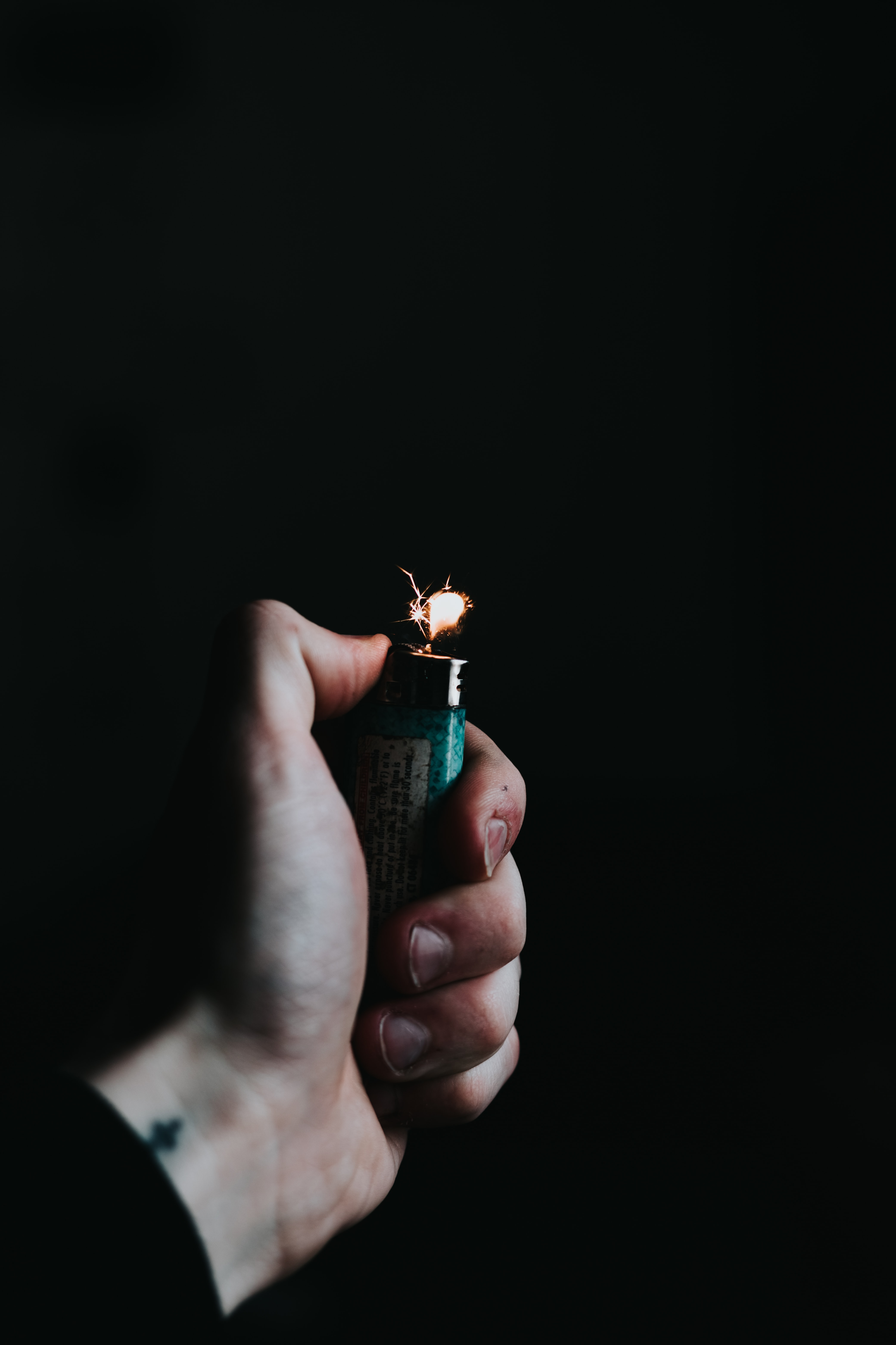 person holding green lighter