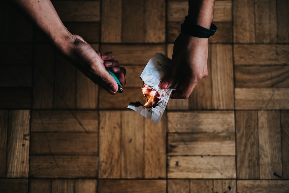 person burning paper