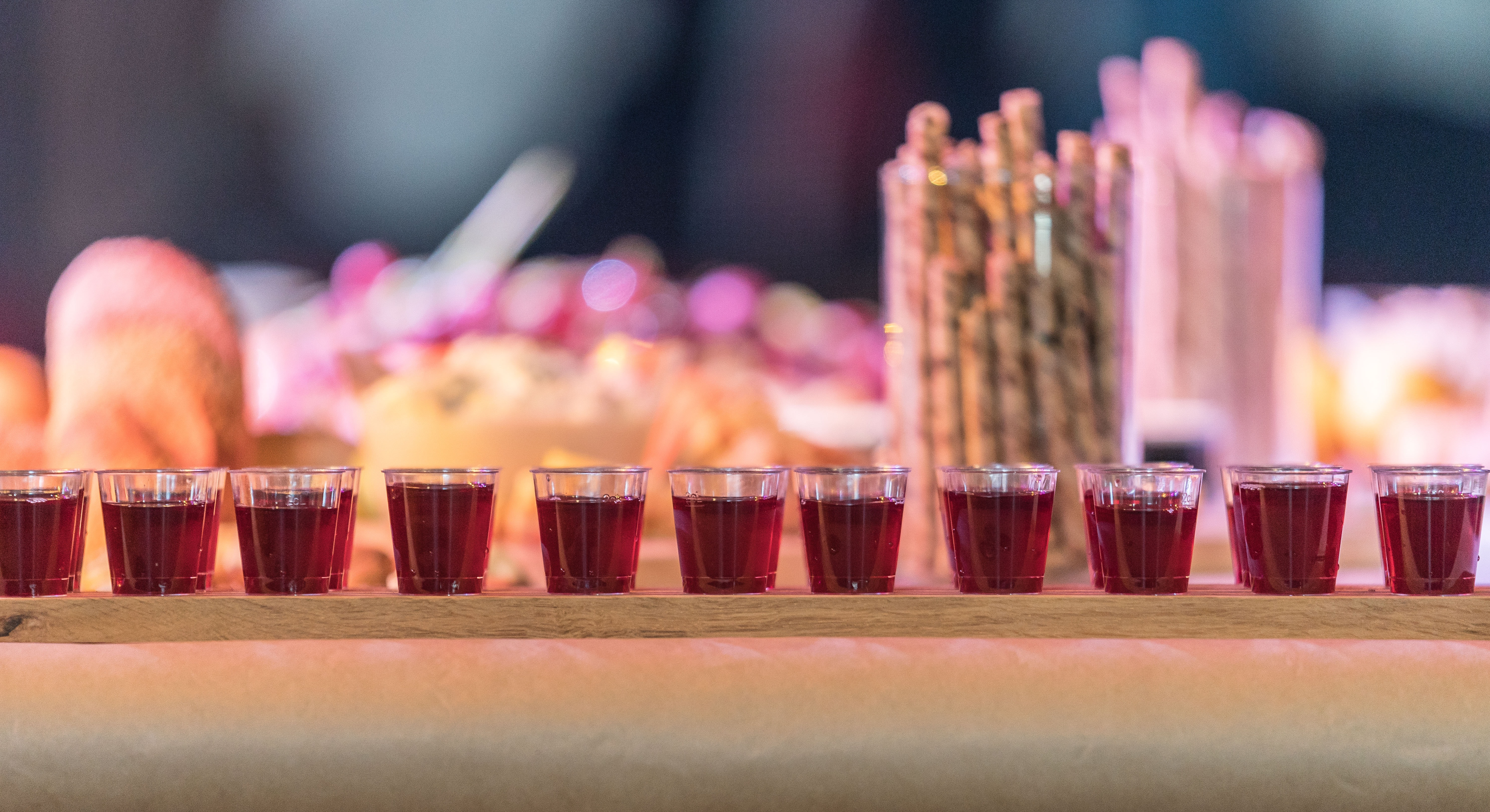 shot glasses filled with red liquid