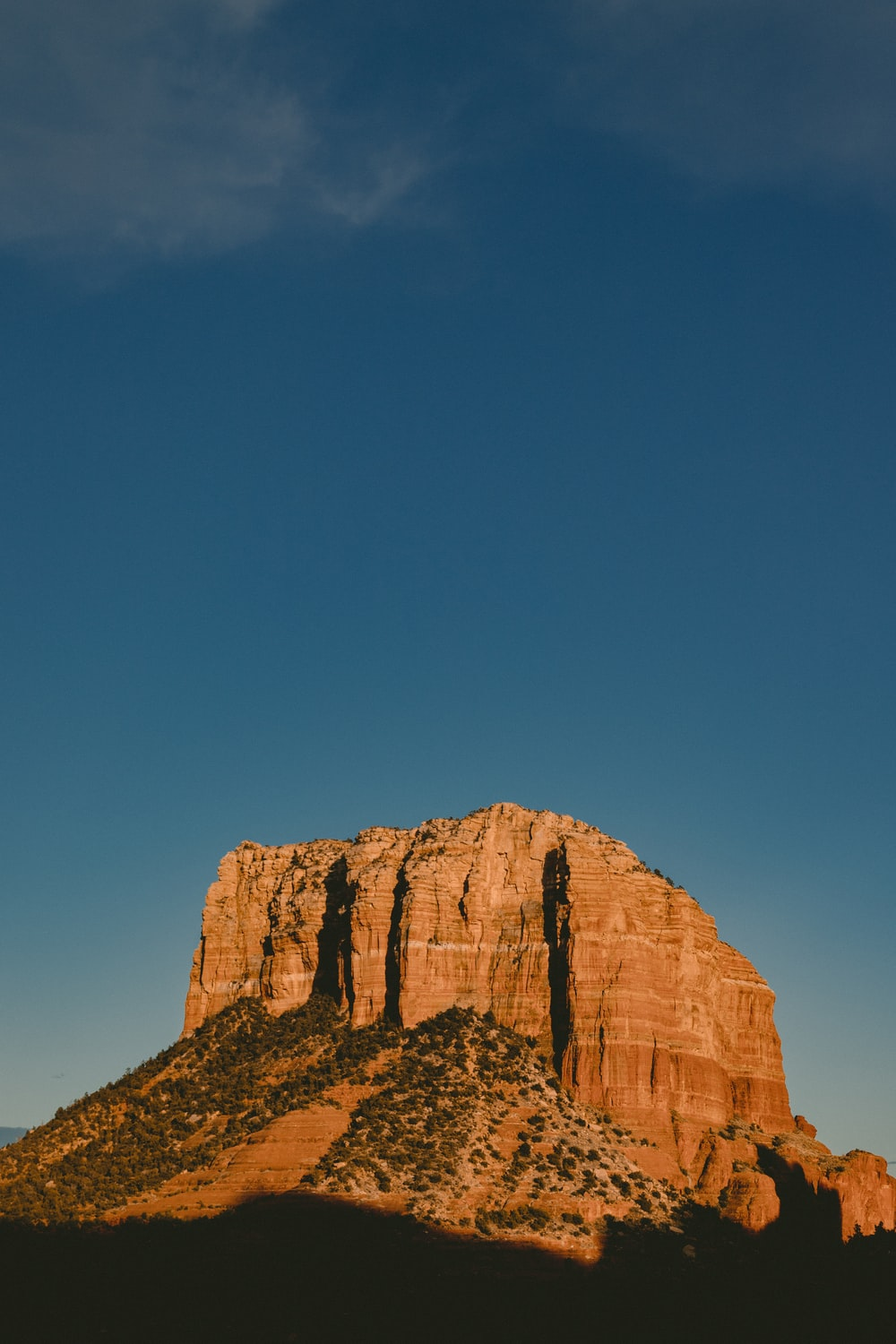 selective focus photography of brown mountain under blue sky