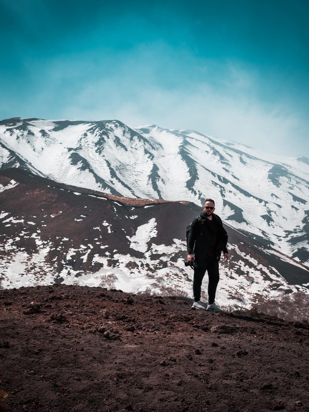 man standing near mountain during daytime