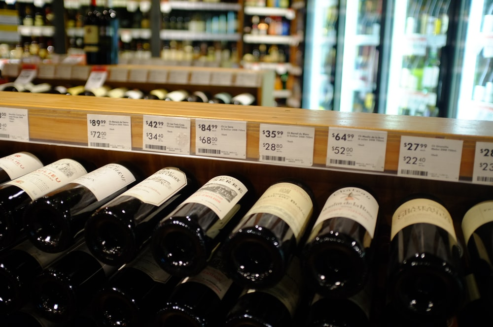 labeled bottles on rack