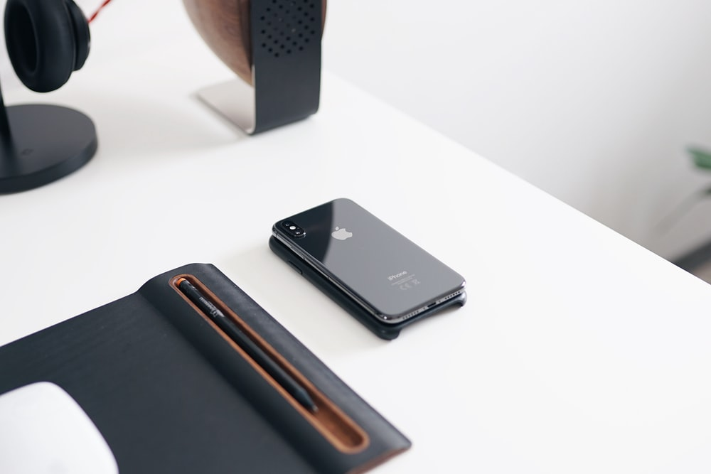 space gray iPhone X on desk
