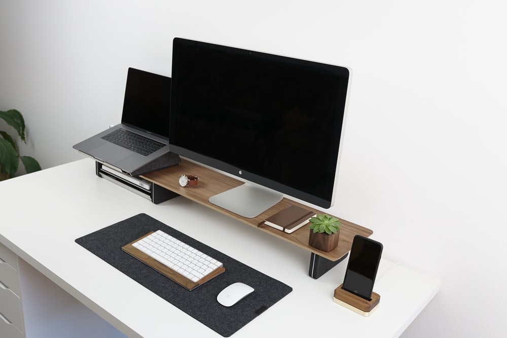 black flat screen monitor on brown and white table