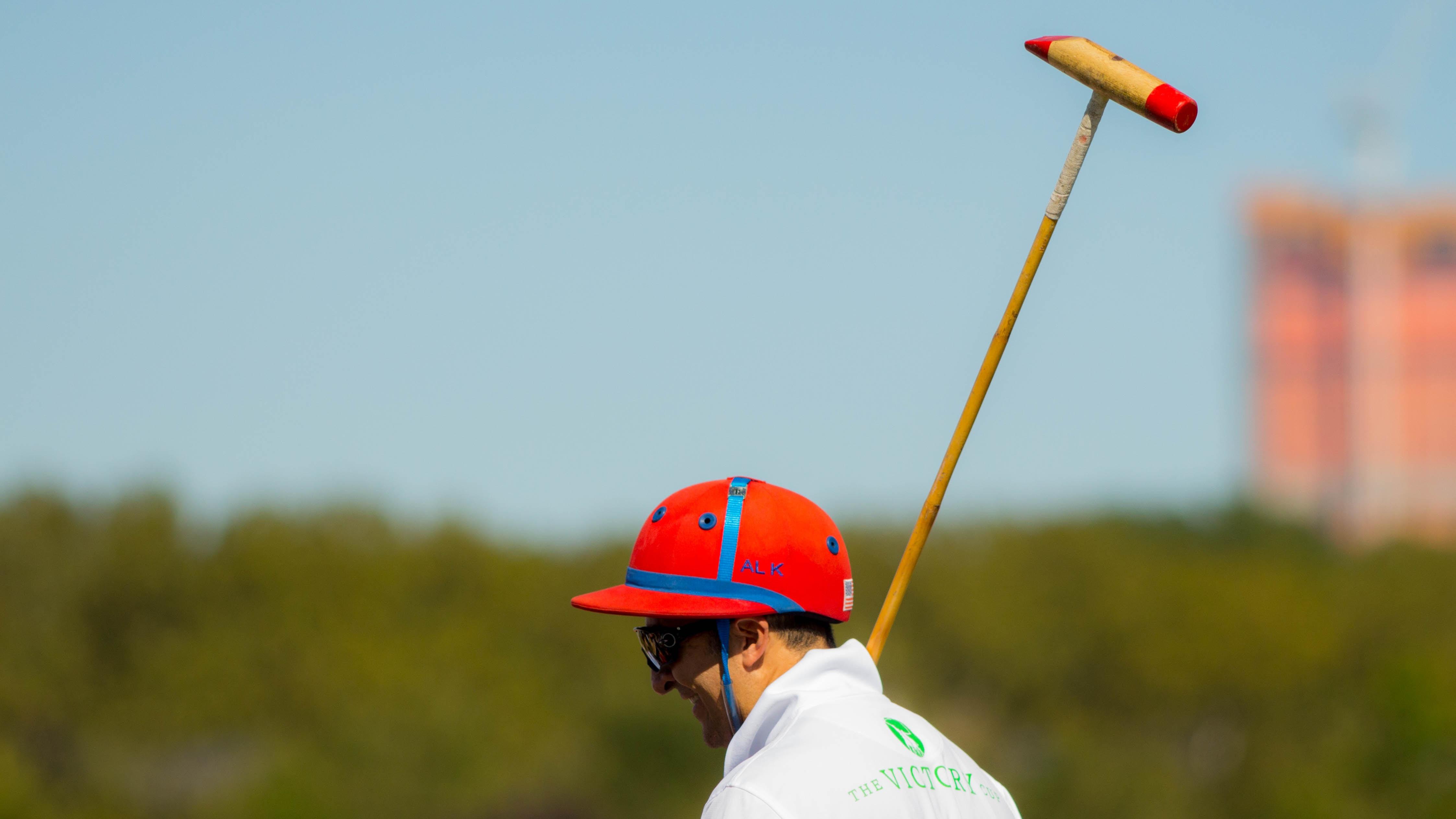 man holding brown wooden stick during daytime photo