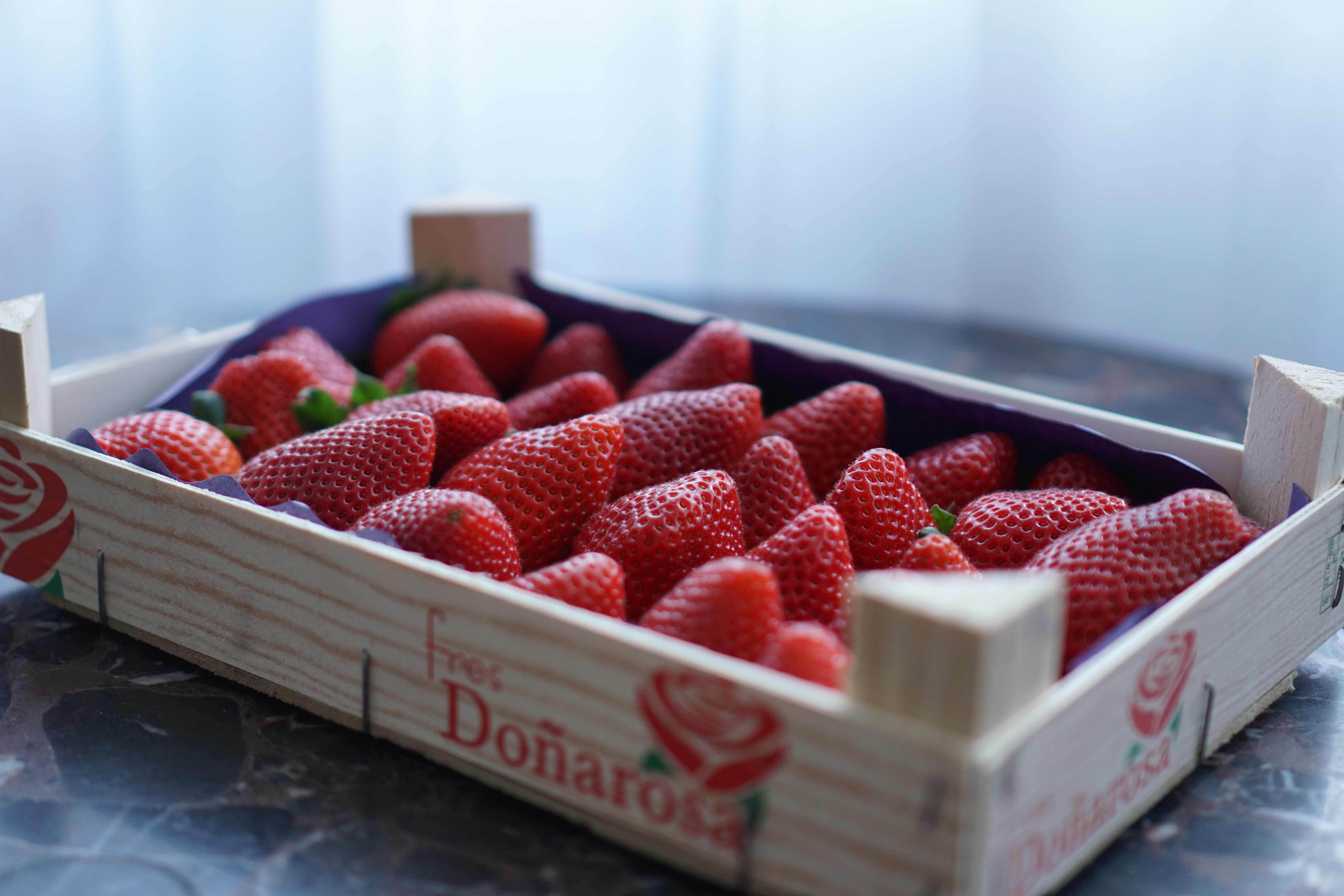 strawberry fruits in brown wooden tray