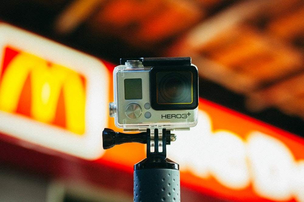 shallow focus photography of silver GoPro HERO3+ camera