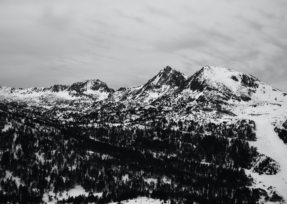black and white mountain covered with snow