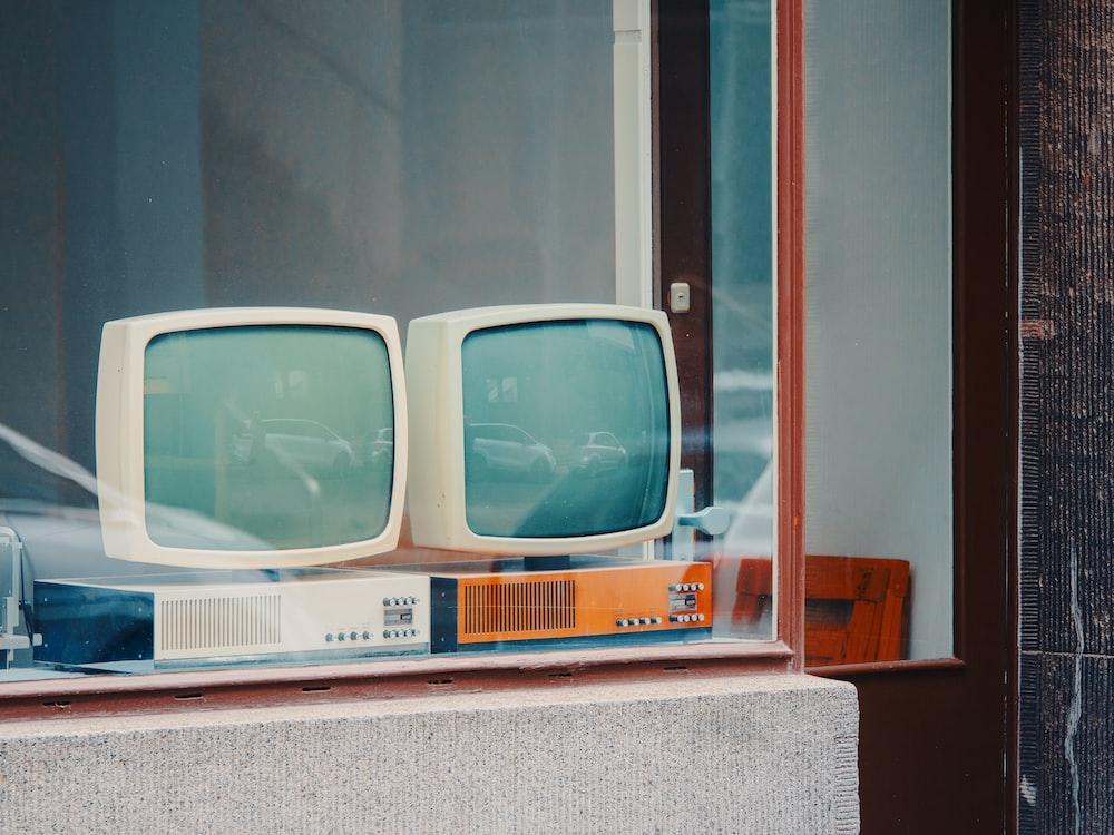 two white CRT monitors display
