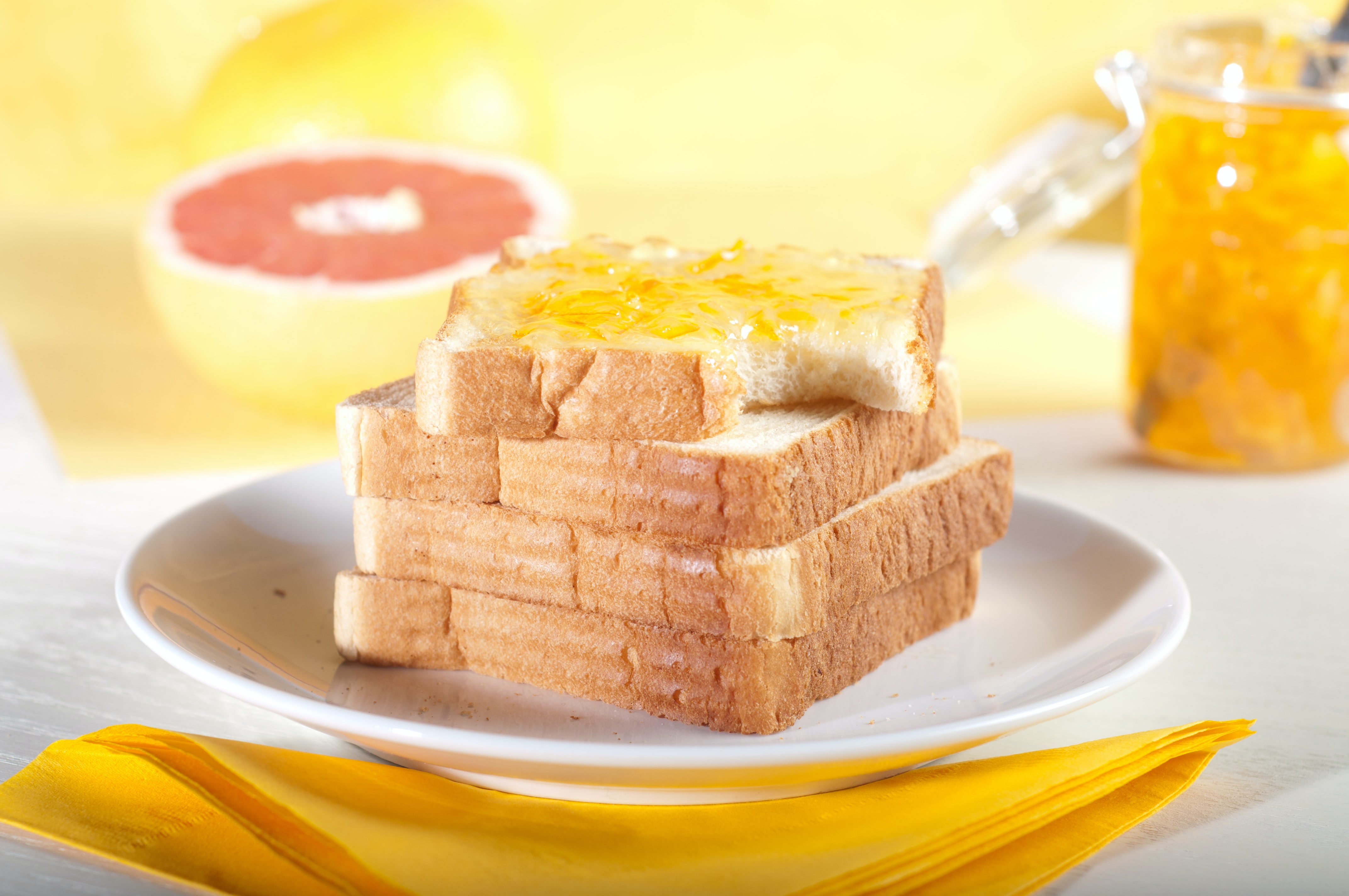 four sliced breads on plate