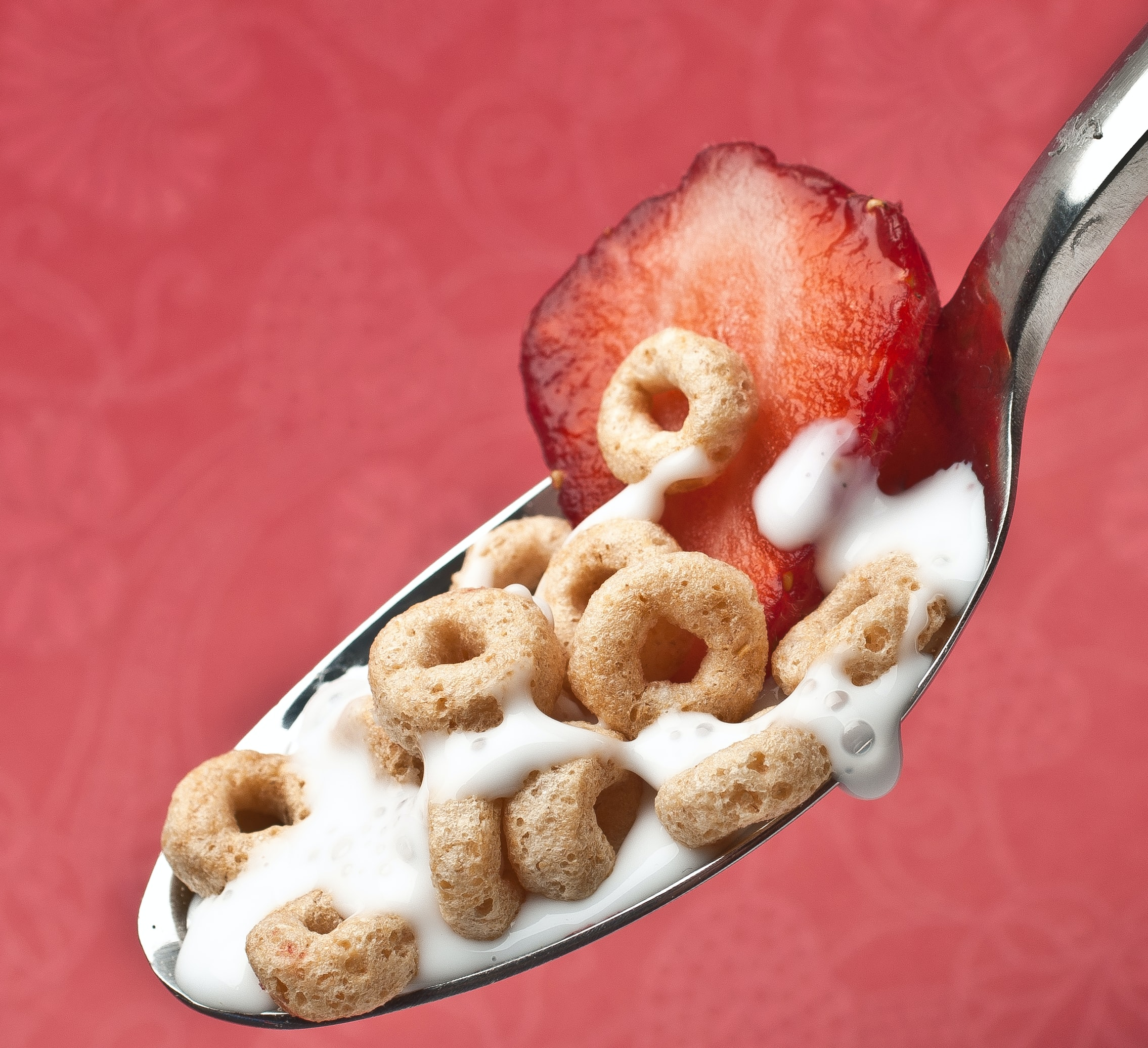 cereal with strawberry on a metal spoon