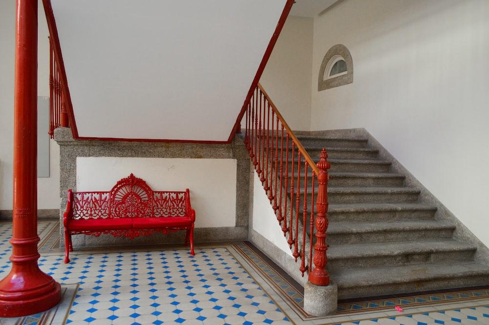 red steel bench near stair