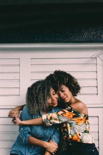 woman hug each other