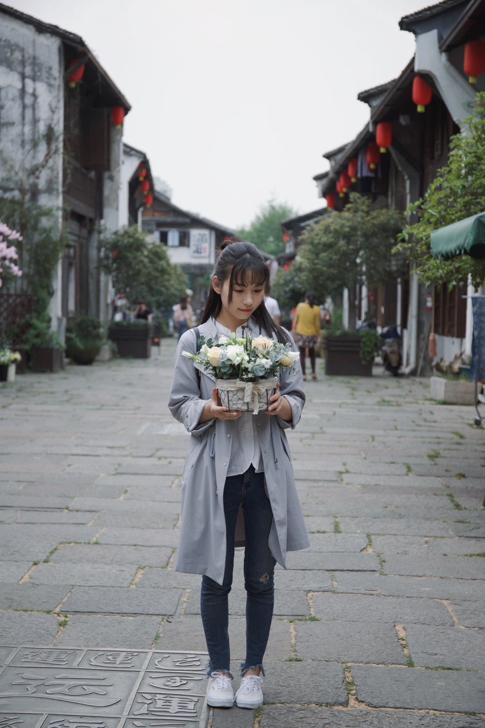 woman holding flowers on basket