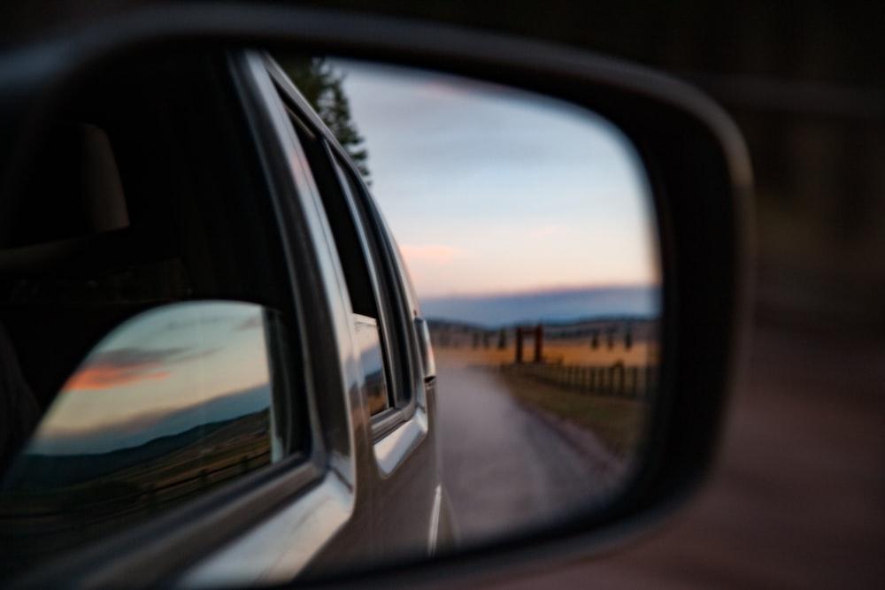 wing mirror reflecting road on desert