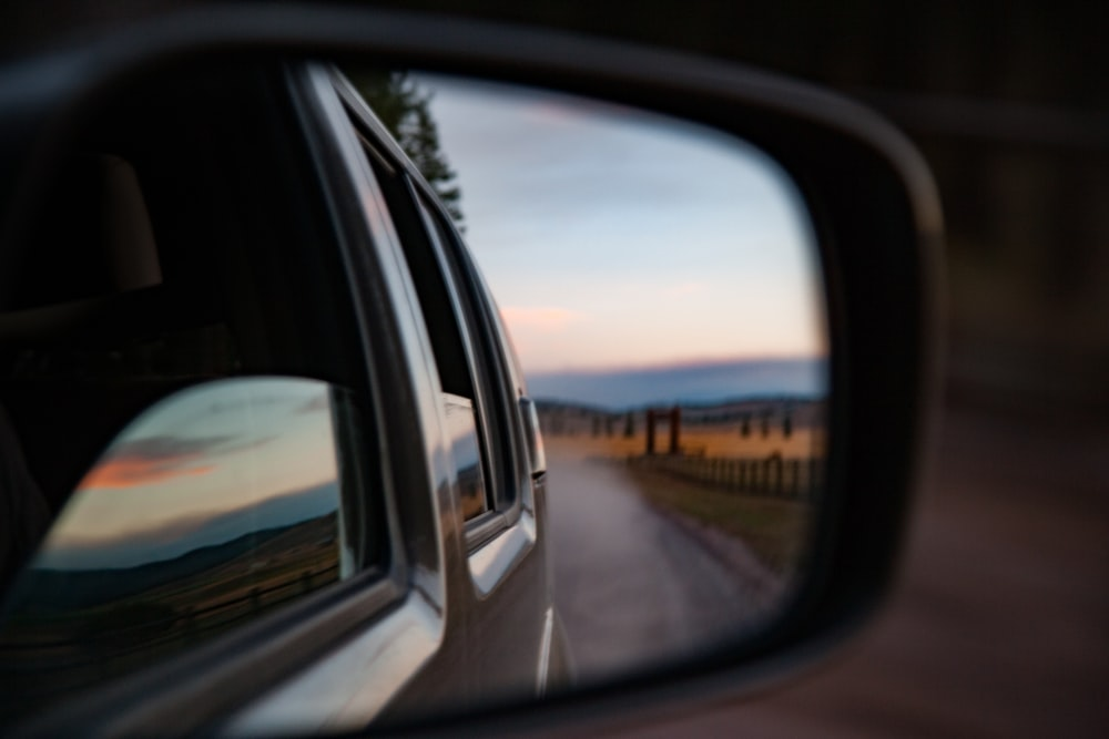 wing mirror reflecting road on desert