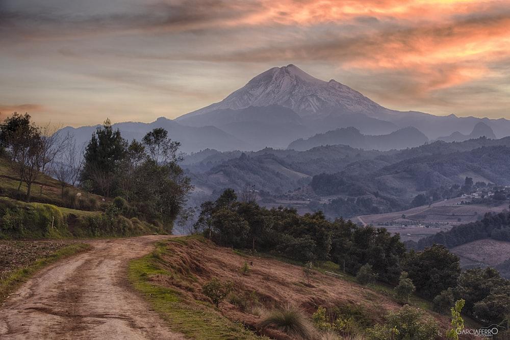 road on mountain leading to mountain