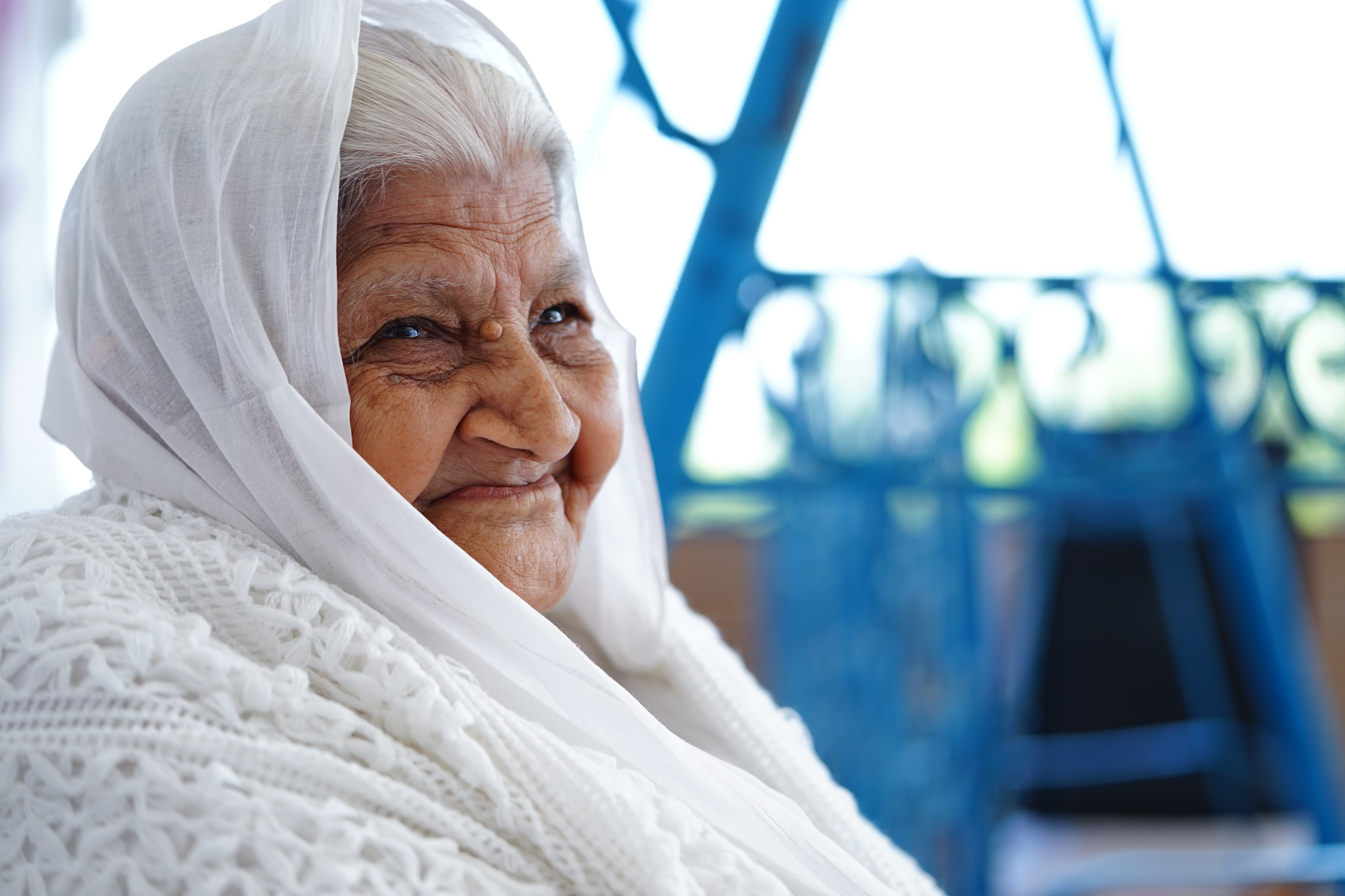 close-up photo of woman sitting while smiling
