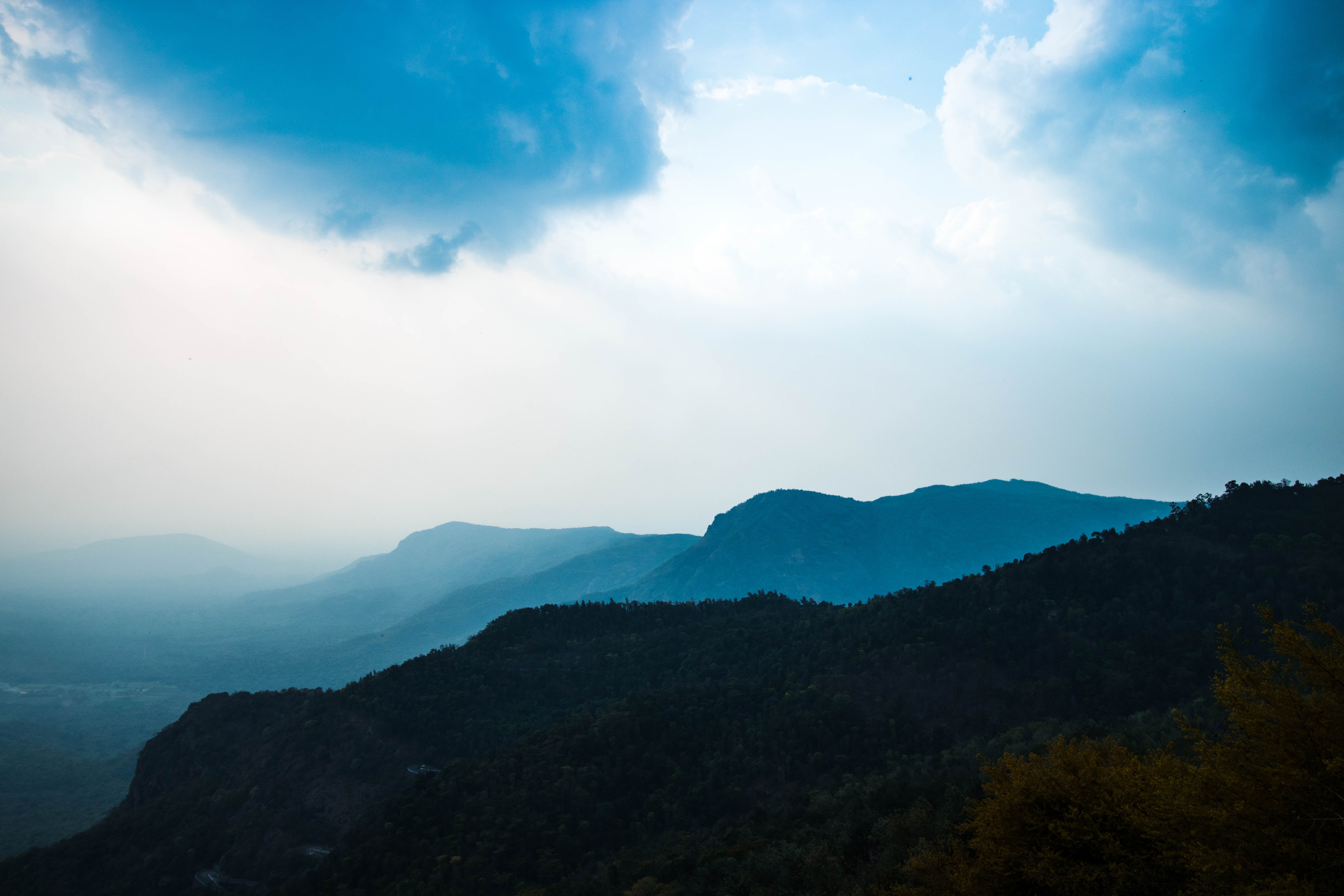 time lapse photography of mountain under clouds