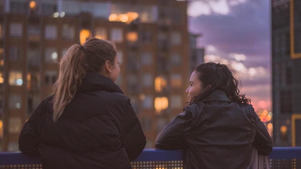 two women standing near railings