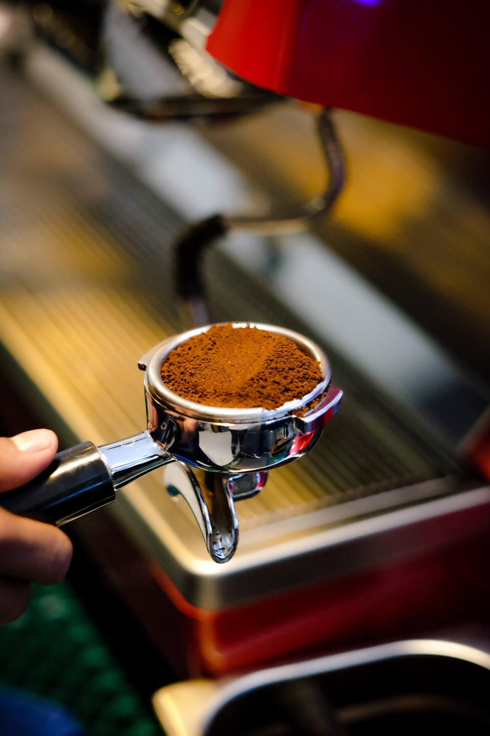 person holding the espresso portafilter