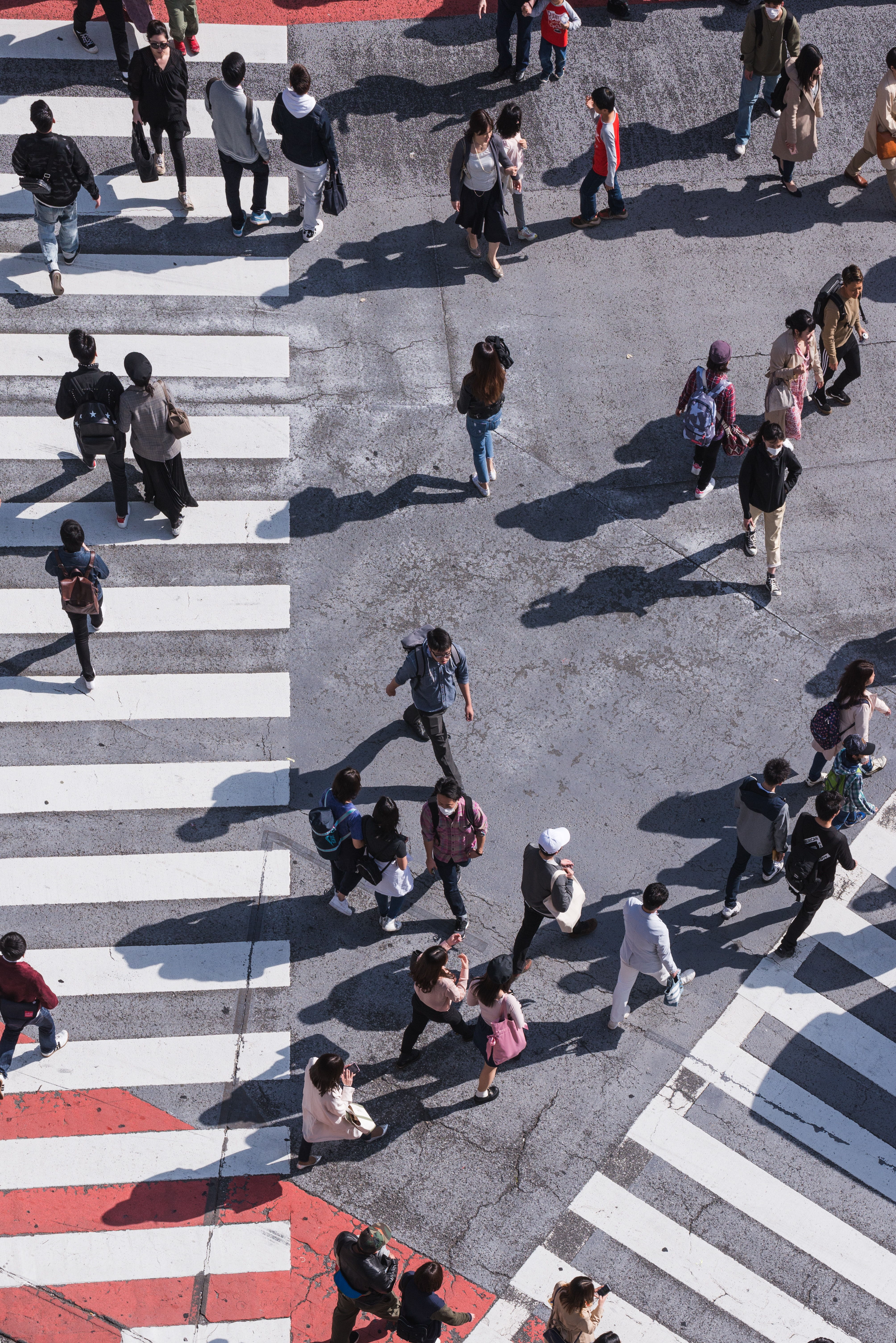 aerial photography of people crossing pedestrian lane