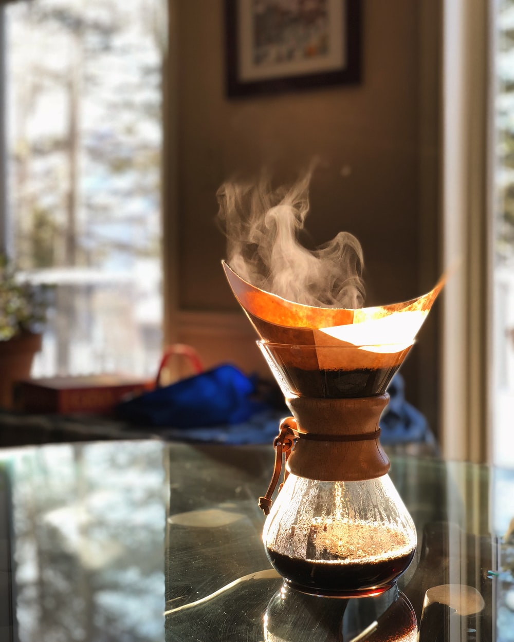 pour-over coffeemaker on glass table