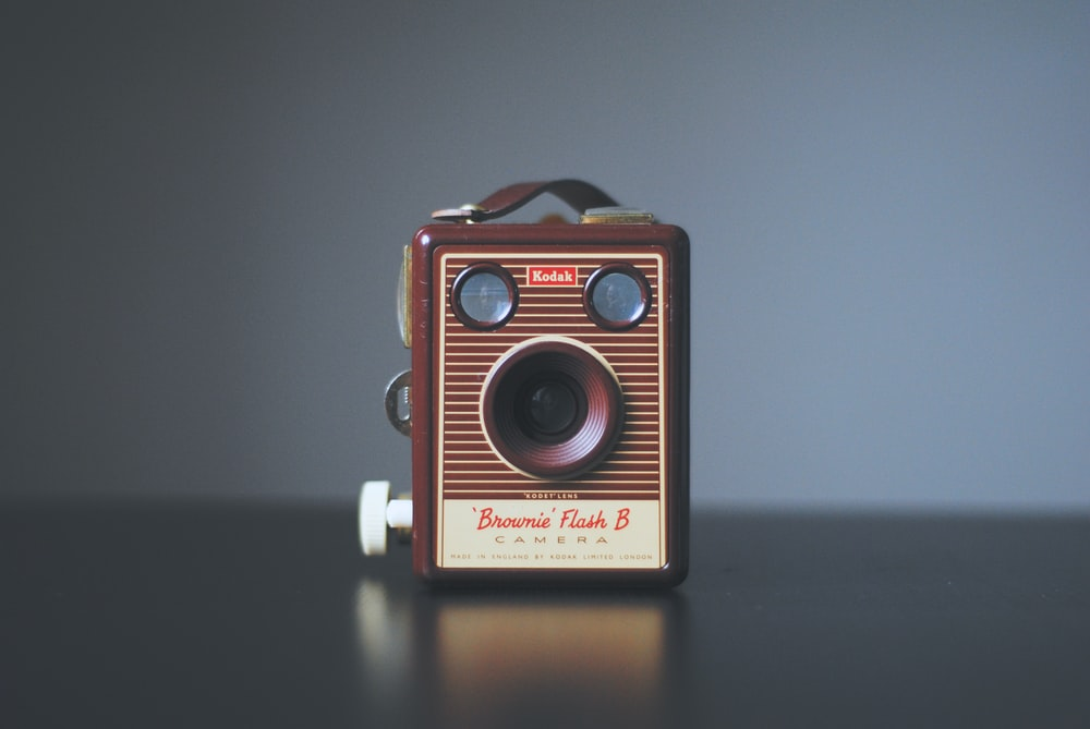 shallow focus photography of vintage brown camera