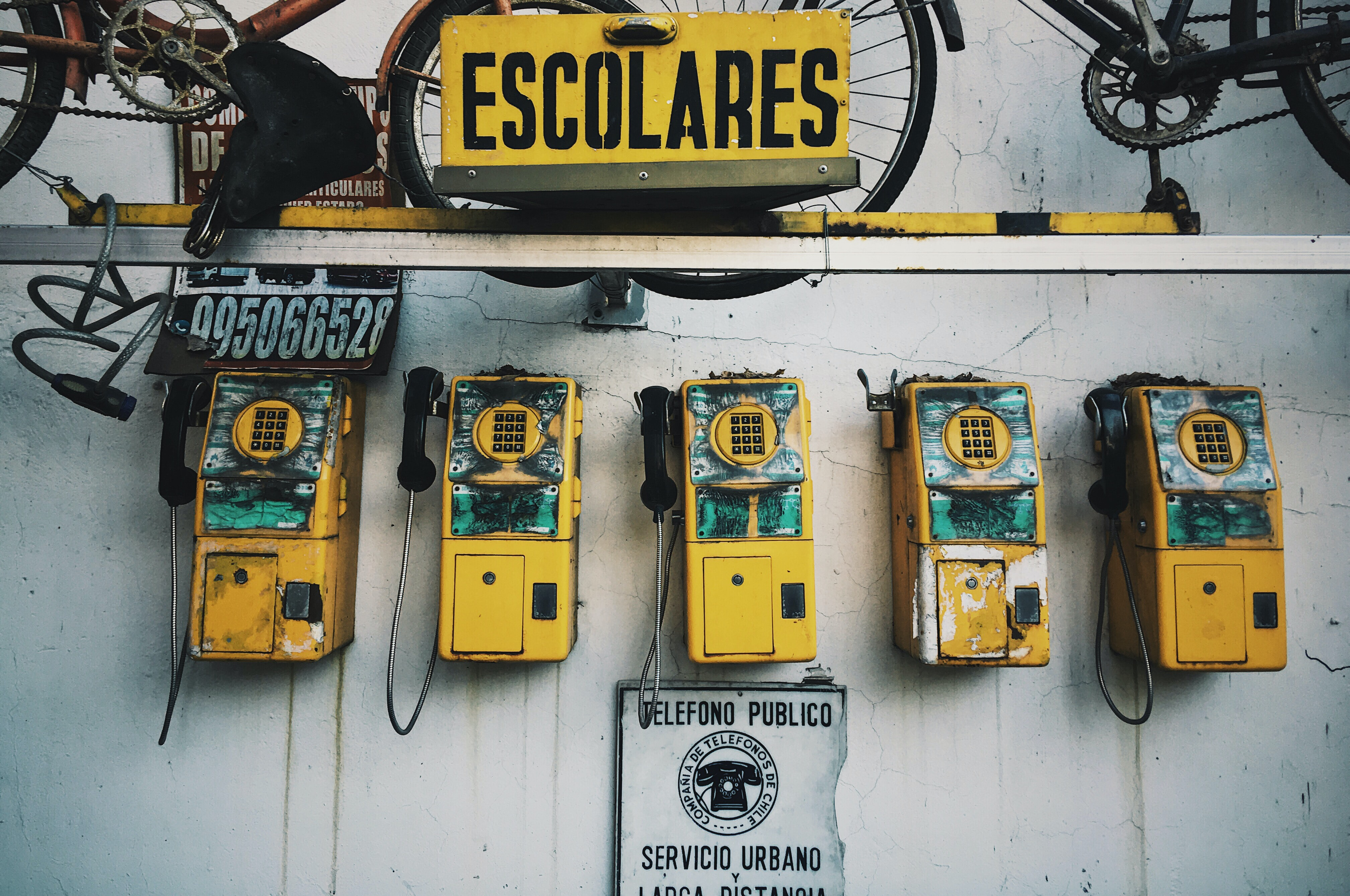 five yellow payphones