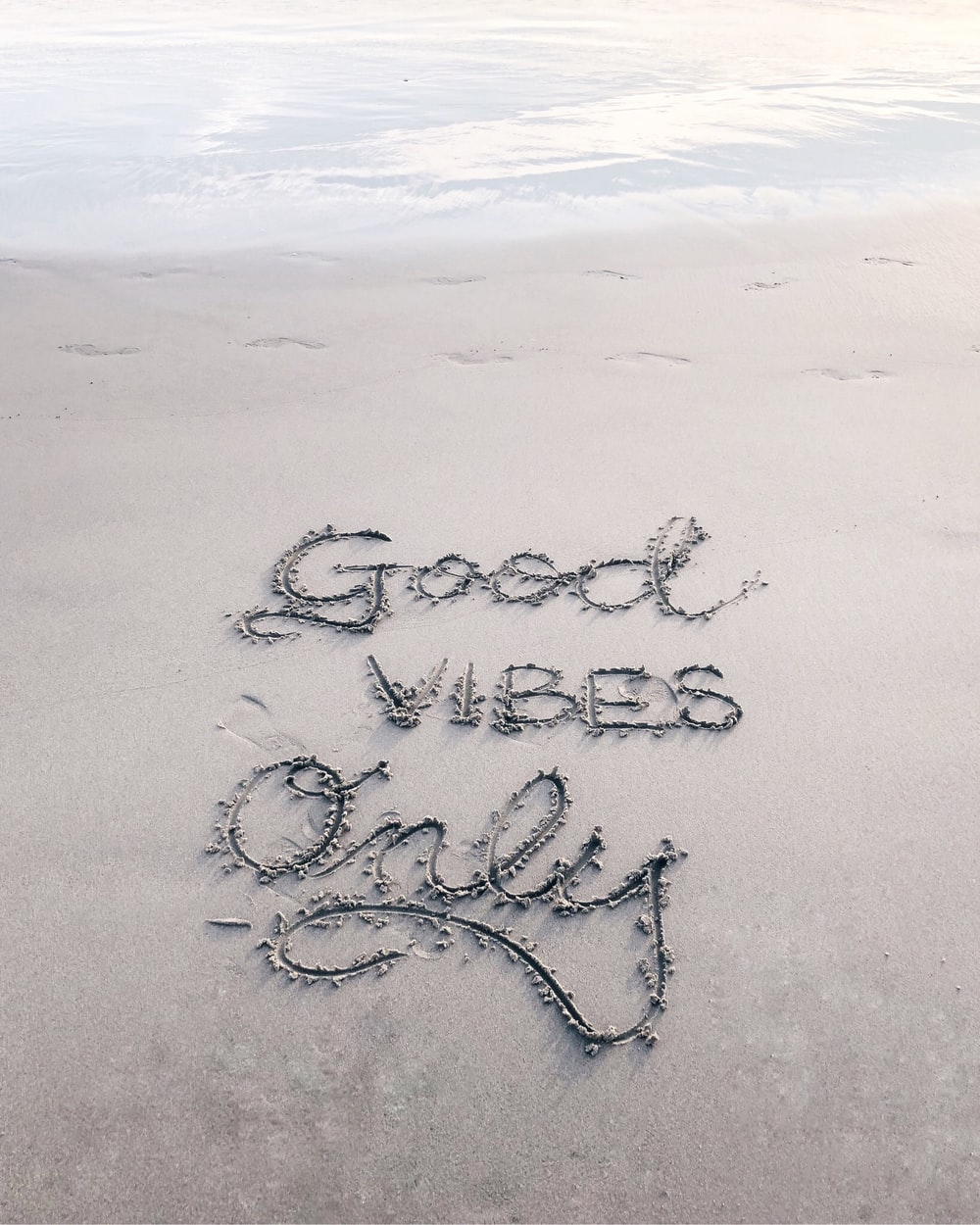 Good Vibes Only sand text